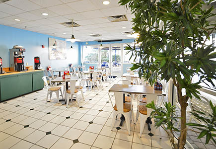 Comfortable and casual indoor seating area in Pelican Beach Cafè